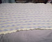 Soft baby blanket in yellow and variegated yarn, lacy pattern with lacy border