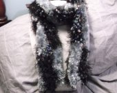 Checkerboard pattern knit scarf in gray and variegated yarns