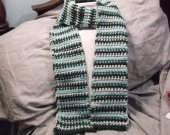 Knit scarf in greens