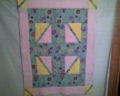 Quilted baby blanket in pink, turquoise and yellow