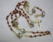 Rosary in red, gold and white with gold base metal Crucifix and Mary medal