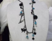 Charm necklace with black charms and turquoise, purple and white beads