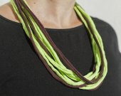 A light green-brown knitting yarn necklace