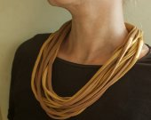 A knitting yarn necklace in brown shades