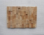 Wood cladding. Unique wooden mosaic pattern. Wall panel.