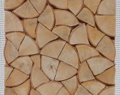 Firewood for fire. Wooden mosaic panel 3d. Wood cladding.Decorative wood panels decorative for walls. decorative panel