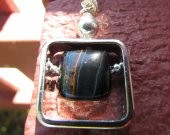 Square pendant with Blue Hawk eye stone.