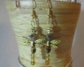 Amber glass dragonfly earrings.