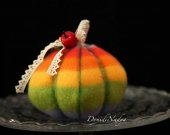 Rainbow pumkin Halloween decoration. Multicolour pumpkin with miniature sunflower, apples and ladybug
