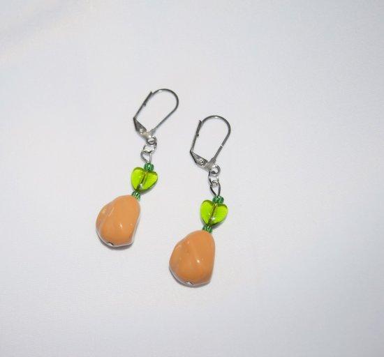 Handmade earrings with tan potato bead, green glass heart and seed beads