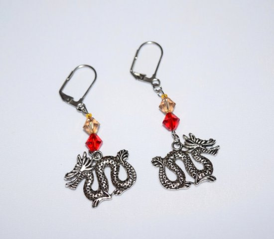 Handmade dragon earrings, dragon charm & Swarovski crystals in red and pale bronze