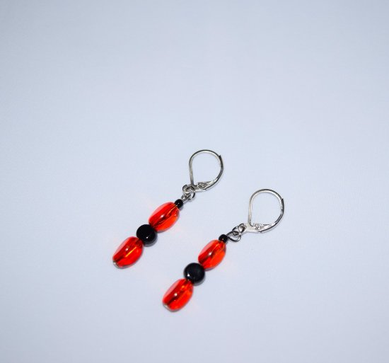 Handmade red earrings, red-orange glass triangles, black onyx coin, seed beads