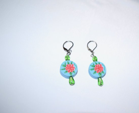Handmade flower earrings, polymer flower disc and green faceted crystal teardrops