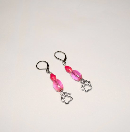 Handmade pink pawprint earrings, translucent pink barrel bead, pink rolled paper bead, pawprint charm