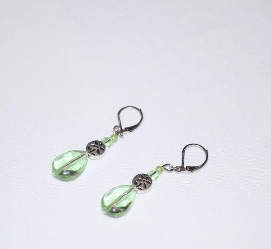 Handmade green earrings, sparkling green teardrop and round beads, oval flower charm