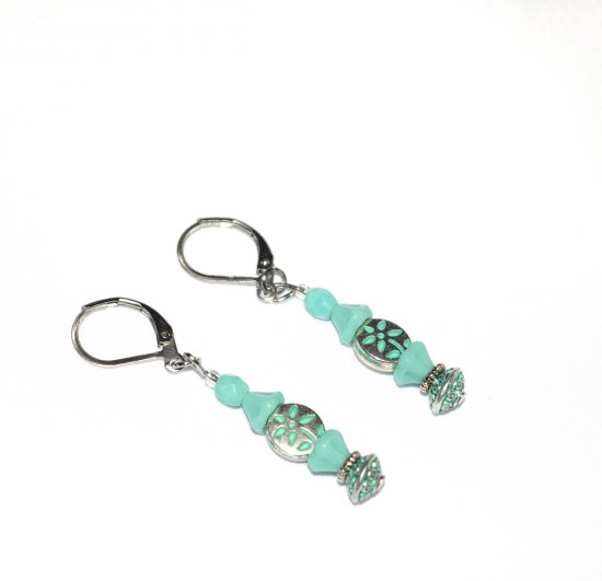 Handmade green flower earrings, mint green glass flower cap and round beads, silver flower oval and rondelle