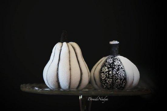 White pumpkins Halloween decor. Stuffed fabric pumpkins