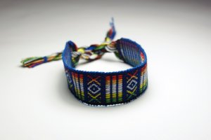 Blue Thread Friendship Bracelet with Red, Green and White Details