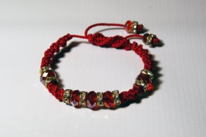 Red Swarovski Thread Bracelet with Golden Decoration