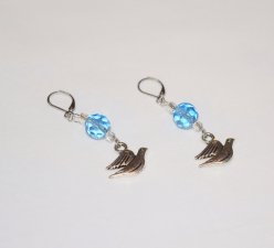 Handmade dove earrings, faceted blue crystal,  silver-lined seed beads and dove charm