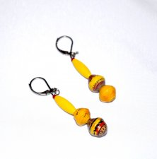Handmade yellow mismatched earrings, yellow wood and yellow and red paper beads