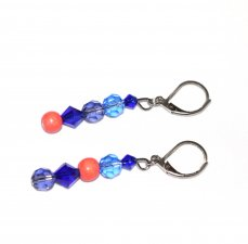 Handmade mismatched earrings, blue and voliet crystals, coral wood beads