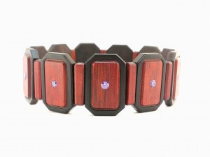 Bracelet made of wood. Synthetic diamond inserts. Wood grab.
