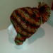 Adult size autumn color beanie with earflaps and pom pom