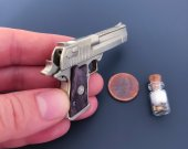 2mm centerfire gun Desert Eagle with removable magazine.