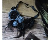 Textile necklace in vintage style with lace, feathers and chiffon