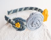 This headband is hand made of denim and wooden beads.