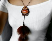 Handmade sweat pendant with natural fur and stone