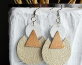 Trendy stylish earrings of geometric shapes in natural skin tones