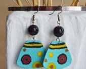 Bright earrings made of genuine leather in turquoise color with a pattern