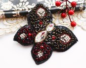 Large beaded butterfly black with red.