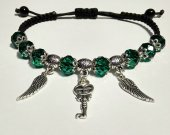 Handmade bracelet with a durable cord, with metal elements. Green