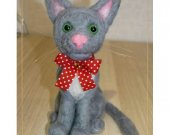 A cat. A toy. Felting from wool