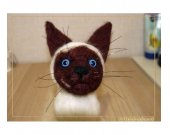 А siamese cat. A toy. Felting from wool