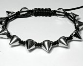 Handmade bracelet with a durable cord. Spikes