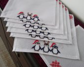 Serviettes are the embroidered decorative Penguins