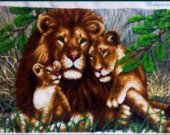 the finished picture is embroidered with beads Lions