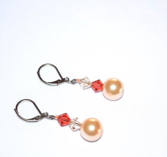 Handmade coral earrings, mismatched with coral and pale honey Czech crystals and a peach glass pearl bead