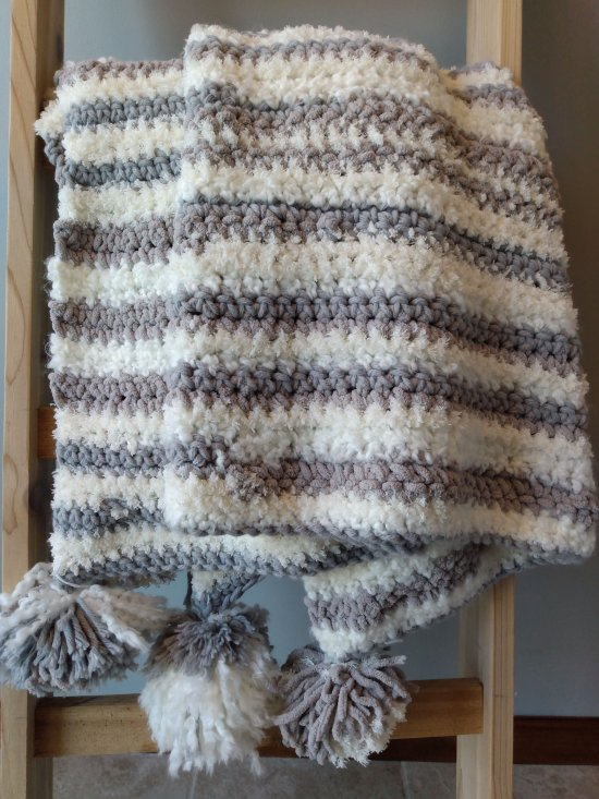 Gray and White Crochet Blanket with Pom Poms