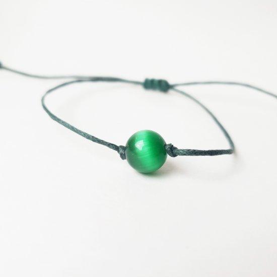 The cat's eye (green) stone bracelet