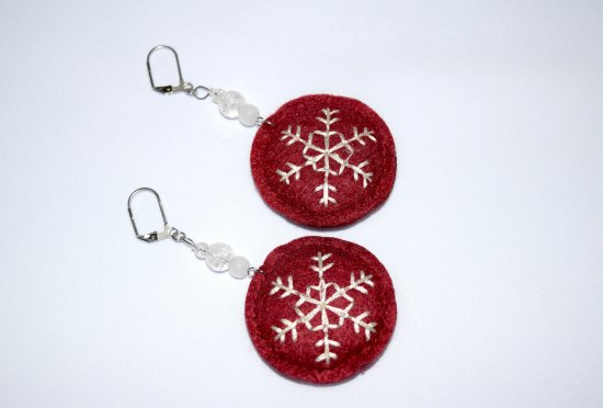 Snowflake earrings with embroidered felt topped by sparkling crackle glass