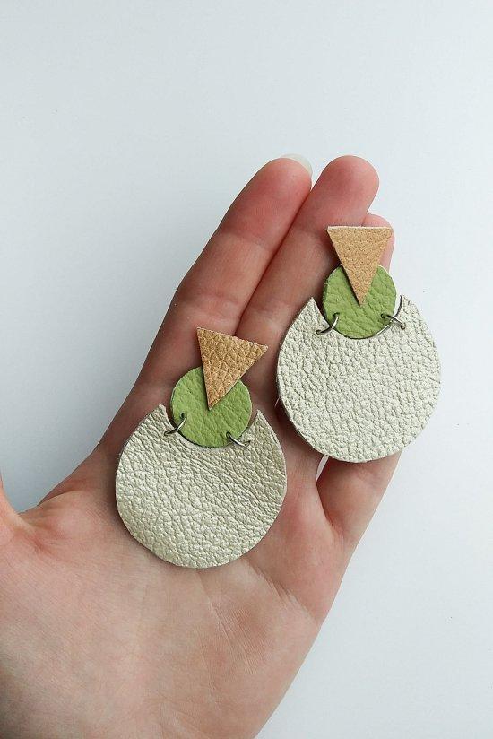 Handmade beige earrings made of genuine leatherin