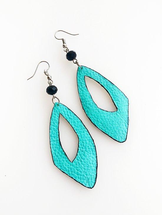 Light blue earrings handmade from naural leather .Summer accessory