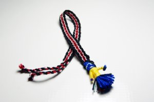 Black and Red Bracelet with Doll