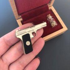 2mm pinfire TT pistol with black wood grips