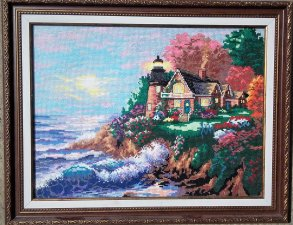 Picture embroidered with a cross the house by the sea